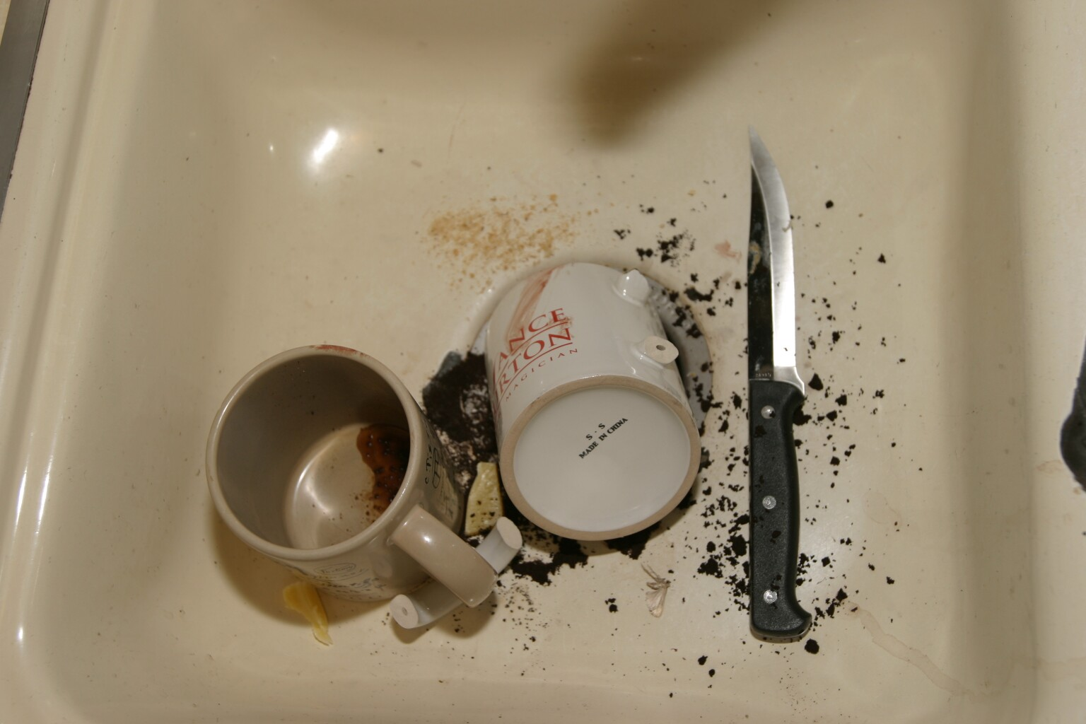 Bloody                                     Cups, Knife, And Coffee Grounds in                                     Sink